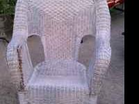 White wicker rocker with one torn spot. Can be fixed