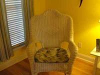 White wicker rocking chair with a cushion. Very good