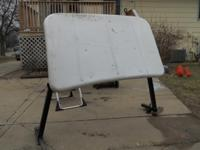 White fiberglass wind deflector with black tubed frame