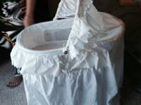 Adorable White Bassinet ready to bring your newborn