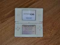 Up for grabs is this awesome white NINTENDO DS LITE! It