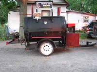This is a handmade pig smoker with lots of