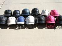 I've got a THIRTEEN girls softball helmets for sale, a
