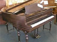 This is a beautifully sounding baby grand piano made in