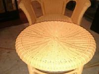 For sale:.  Bright orange wicker chair and ottoman. We