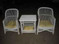 Older wicker chairs and center table in good condition