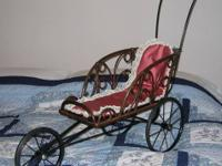 This collectible child-size (not a miniature) doll pram