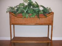 "Wicker Plant Stand. 29"" high, 33""wide, 11"" deep. Silk"