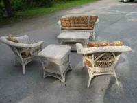 Nice 5 piece wicker/rattan set. 2 chairs, i loveseat, 1
