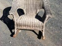 Matched pair of children's wicker rockers.  Natural