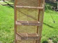 Wicker shelving unit with removable shelves. Measures