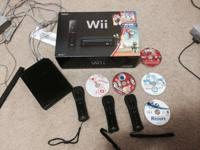 Black wii with 3 controllers, 5 games, and 2 nunchucks