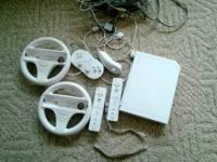 White Wii with 2 controllers, 1 timeless controller, 2