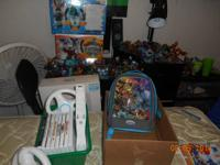 In box Wii system with 2 controllers Spongebob U-draw