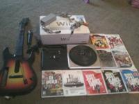 I am selling a Wii console, Guitar Hero guitar, Guitar