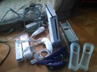 Wii with additional remotes and over 6 games. All