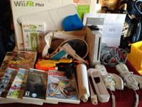 Wii console, wii Fit plus board and video game, 9 video