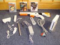 For sale is a Wii Console, Cabela's Rifle, Games &