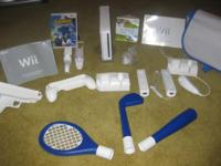 WII FAMILY GAMING SYSTEM. FEATURES GOLF, BASEBALL,