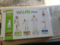 WII FIT BOARD IN BOX W/ GAME $20   show contact info