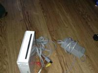 Selling wii (no remote) but does come with ac adapter