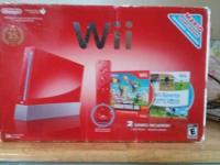 Red Mario edition Wii console with three game