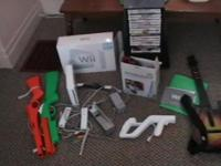 wii game system 16 + games and accessories guitar 2