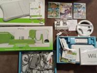 Complete Wii system  2 controllers(one w/cover) 1