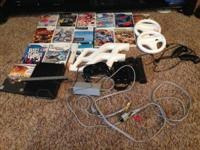 Wii game system in black with extras including 2