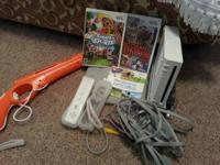 Wii gaming system that includes 2 controllers, 3 games,