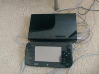 Selling a used Wii U 32gb Deluxe system for $210. The