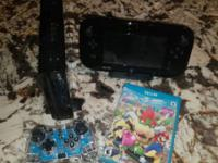Hardly used Wii U 32 Gb black console and game pad,