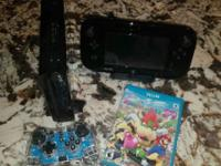 Hardly used black 32 Gb Wii U Console and Game Pad.