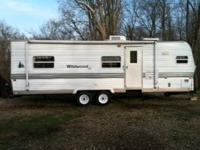 2002 wildwood 28FKSS. 28 foot with slide. front kitchen