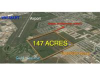 147 Acres + or - in City Limits with utilities to the