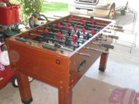 This is a working foosball table. Some edgewear and