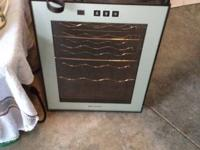 Brand new wine cooler.  Only been used once.  Holds 12