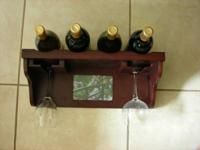 Unique wall mounted rack / shelf that holds 4 bottles