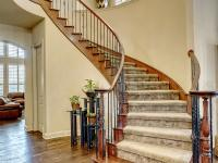 Elegant Curved Iron Staircase Welcomes as You Enter