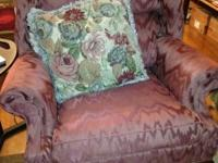 Wing back chair. Very comfortable. Needs to be