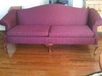 Burgundy sofa , newly recovered in great condition. If