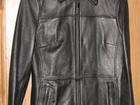 This is a black leather winter coat, tailored fit, zip