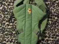 This is a lightly used carrier. light green with winnie