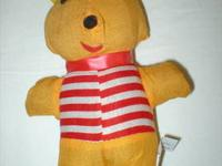 This vintage Winnie the Pooh stuffed cloth doll