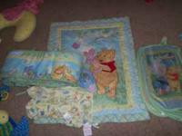 comes with a dust ruffle, crib sheet comfoter, hamper,