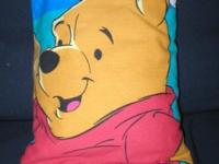 This Winnie the Pooh pillow has a customized made cover