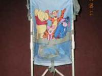 Winnie the pooh stroller only used once. Great