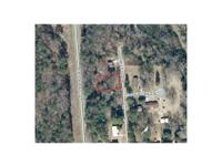 .22 Acre wooded lot, call Russ Brown for more details