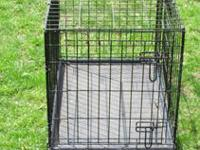 I have for sale a heavy duty black wire dog kennel /
