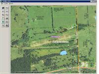 27.41 acres m/l situated on hilltop/ridge site. Part of